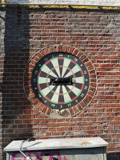 Close-up of clock on brick wall