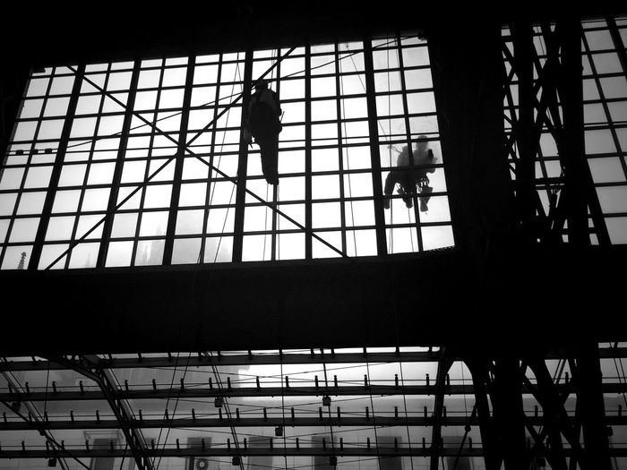 Behind the scenes: cleaning a train station Architecture Blackandwhite Built Structure Ceiling Contemporary Full Frame Glass - Material Indoors  Light Low Angle View Metal Modern Pattern Repetition Safety Silhouette Structure Train Station Transparent Window IPS2015Architecture Alternative Fitness Colors And Patterns Monochrome Photography