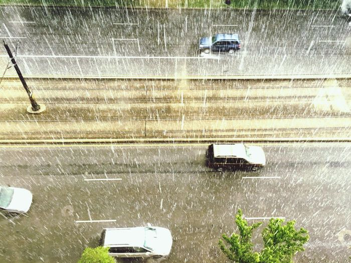 High angle view o cars on road during rainy season