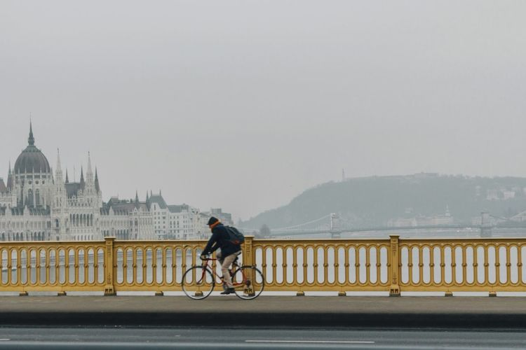 Man Cycling Bridge Bycicle Lovers Bycicle In The City Sport Activities Healthy Lifestyle Cycling Bicycle Fog Outdoors Budapest - Hungary Budapest View Transportation Parliament Of Hungary Hungarian Danube Bridge