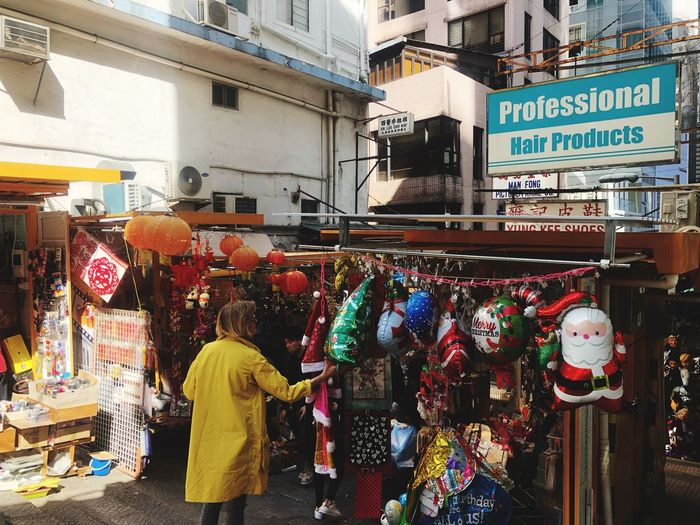 Streetphotography Christmas Decoration Building Exterior Architecture Text Store Small Business Built Structure Market Day Outdoors Real People City