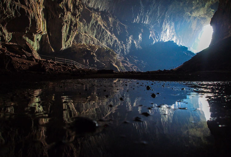 Reflection On Lake In Cave During Sunny Day