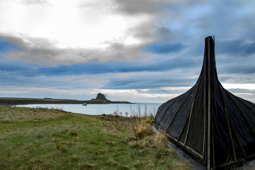 Island view Lindisfarne Castle Beauty In Nature Cloud - Sky Currough Day Grass Holy Island Castle Horizon Over Water Nature No People Outdoors Scenics Sea Sky Upturned Boat Water