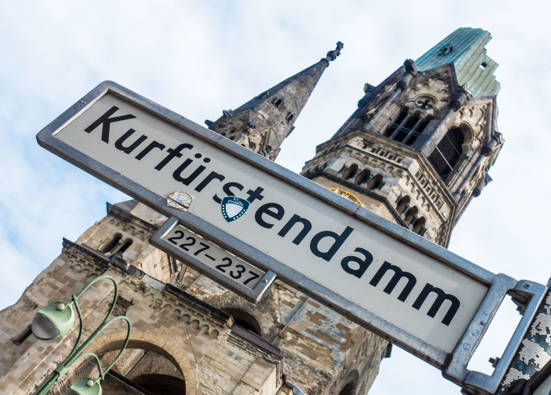 Architecture Building Exterior Built Structure Close-up Cloud - Sky Communication Day Famous Place Guidance Kaiser-Wilhelm-Gedächtnis Kirche Kudamm Kurfürstendamm Low Angle View No People Outdoors Road Sign Sky Straßenschild Street Name Sign Street Sign Text Western Script