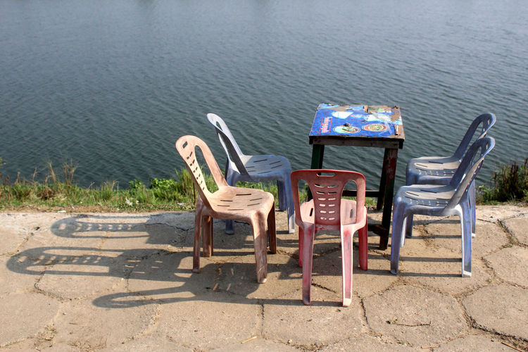 Chair Seat Absence Nature Empty Water No People Day Beach Table Tranquility Sunlight Outdoors Land Shadow Furniture Outdoor Chair