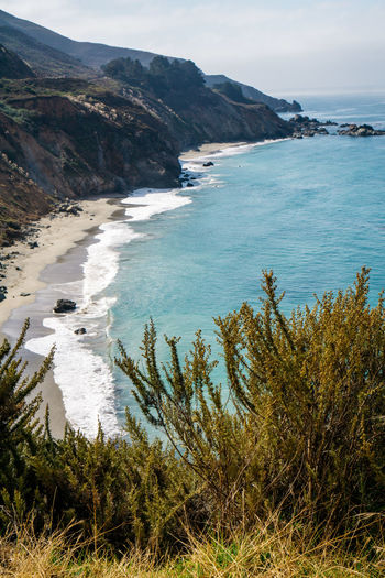 Beach Beauty In Nature Day Grass Horizon Over Water Mountain Nature No People Outdoors Scenics Sea Sky Tranquil Scene Tranquility Travel Destinations Water Wave