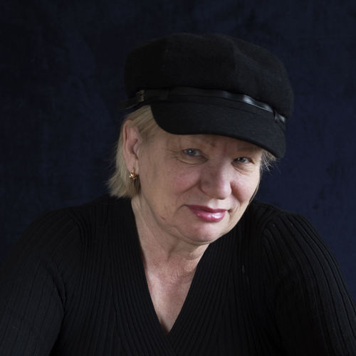 middle-aged woman in cap Black Background Cap Casual Clothing Caucasian Close-up Focus On Foreground Front View Headshot Hood - Clothing Jacket Leisure Activity Looking At Camera Middle-aged Person Portrait Studio Shot Warm Clothing Woman Young Adult