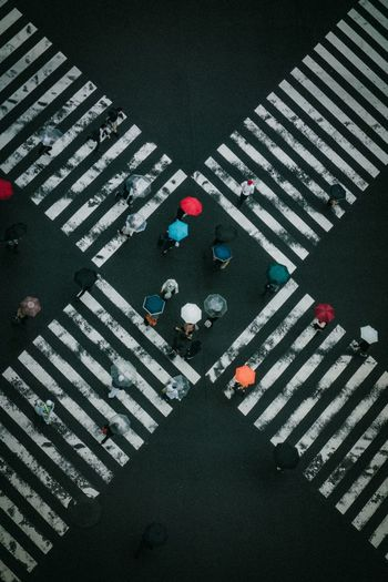 Traffic Crossroad High Angle View Pattern Full Frame Backgrounds Road City Day Marking Indoors  Transportation Design Street Road Marking Textured  Real People Sign Carpet - Decor