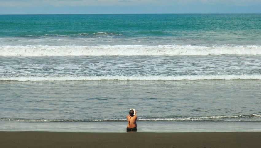 Sea Water Beach Horizon Over Water Scenics Shore Tranquil Scene Vacations Tourism Tranquility Idyllic Standing Tourist Beauty In Nature Rear View Remote Leisure Activity Solitude Wave Coastline Reading Bookworm Surf Playahermosa Playaherradura