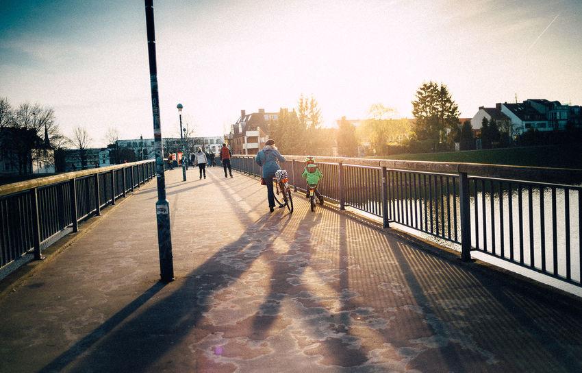 28mm Bikes Bremen Bridge City City Hood Leica Outdoors People Real People Sea Shadow Sunlight Sunlight Tree VSCO