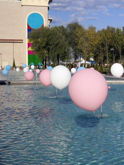 View of balloons in swimming pool against trees