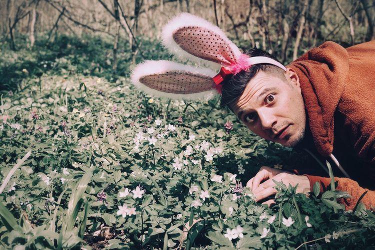 Portrait Of Young Man Wearing Bunny Ear Headband In Park
