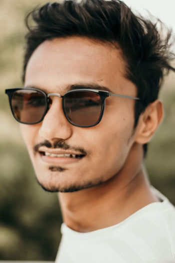 Portrait Glasses One Person Headshot Real People Focus On Foreground Close-up Lifestyles Front View Looking At Camera Young Adult Leisure Activity Fashion Smiling Young Men Eyeglasses  Sunglasses Day Outdoors Human Face Hairstyle Teenager Springtime Decadence The Portraitist - 2019 EyeEm Awards