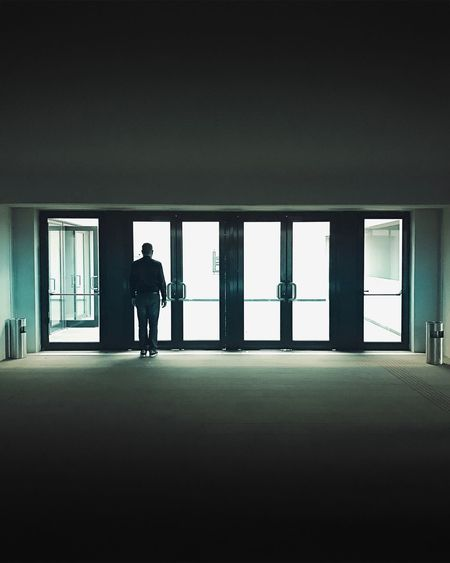 Full Length Indoors  One Person Silhouette Men Window Architecture Real People Day Built Structure Lifestyles Business One Man Only Adult People The Week On EyeEm Getty+EyeEm Collection Getty X EyeEm Gettyimagesgallery Minimal Gettyimages EyeEm Selects HUAWEI Photo Award: After Dark