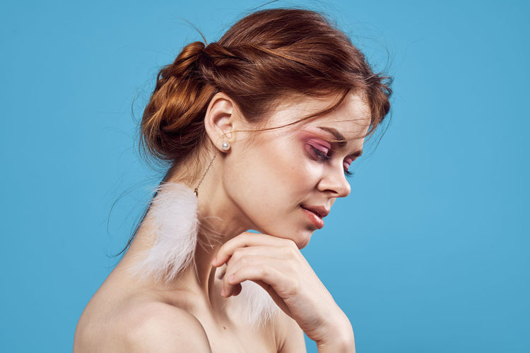 Young woman against blue background