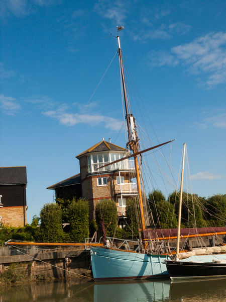 Faversham Iron Wharf Kent Architecture Boatyard Building Exterior Built Structure City Day Faversham Golf Club Harbor Iron Whafe Kent Nature No People Outdoors Red Sails Sky Thames Barge Tourism Travel Travel Destinations Vivid International Water Wharf Wooden Boat
