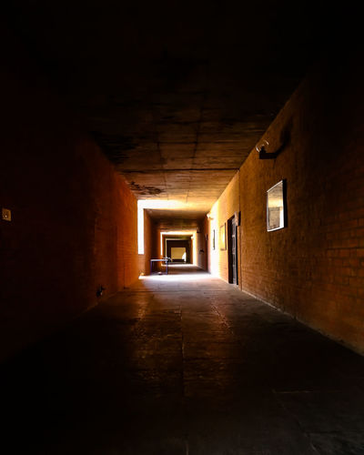 Louis Khan IIM Ahmedabad hallway Louis Khan Iim Ahmedabad Ahemedabad School Ornaments Detailings Light Tunnel Lights Master Of Light Light And Shadow Shadow Clay Tiles Tiles Illuminated Abandoned Corridor Architecture Built Structure Confined Space Passageway Historic Passage Lane Destinations Archway Aged Diminishing Perspective Hallway Tunnel Old Ruin