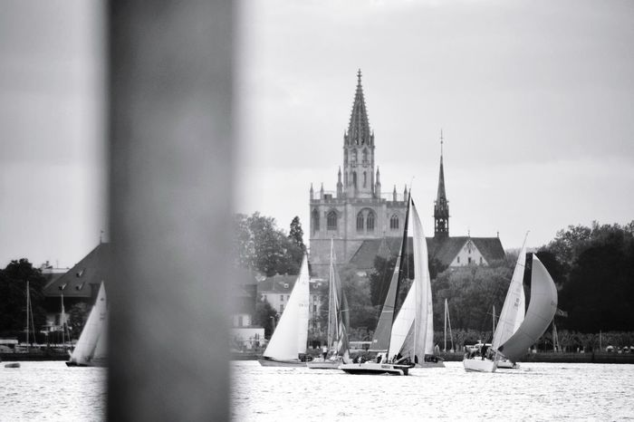 Sailboat Regatta Church Tower EyeEm Best Shots EyeEm Gallery EyeEm Selects Taking Photos Taking Pictures My Point Of View Lake Lake View Lake Constance Landscape_Collection Landscape_photography Landscapes EyeEm Best Shots - Black + White Blackandwhite Black And White Black & White Monochrome City Cityscape Clock Tower History Cultures Place Of Worship Architecture Tower Urban Skyline