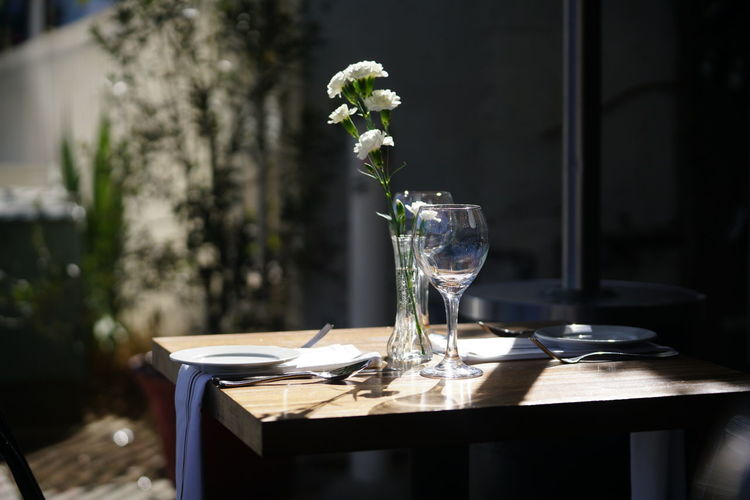 Outdoor table for restaurant Meal Absence Close-up Day Dine Dining Dining Table Drink Drinking Glass Eat Flower Food Food And Drink Gourmet Indoors  Napkin No People Place Setting Table Vase Wineglass