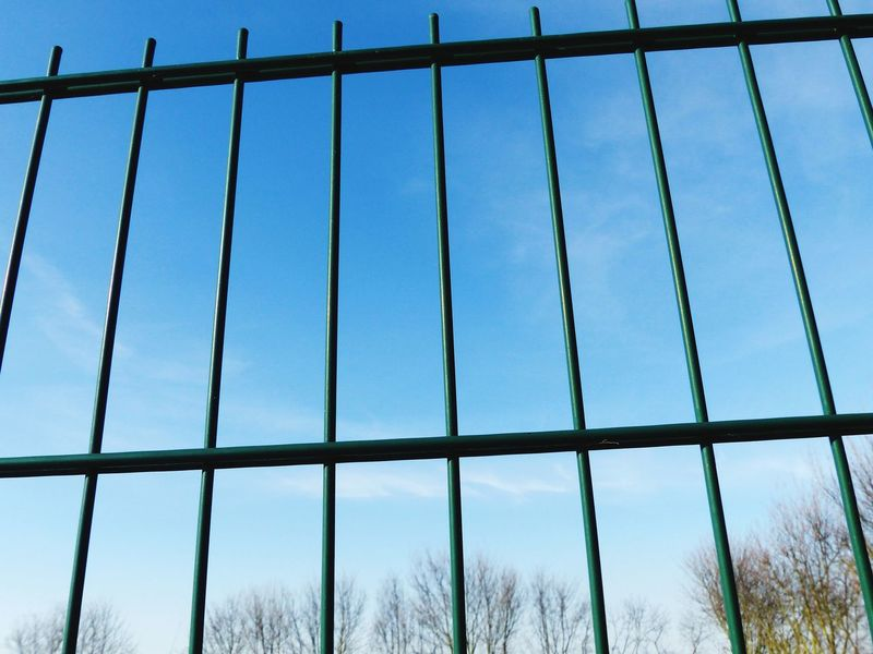 Metal No People Outdoors Close-up Steel Sky Day Geometry Pattern Fence Fenced In In A Row Background Mesh Fence Prison Pattern Low Angle View Background Texture Built Structure Geometric Shape Geometric Structures Grid Clear Sky Blue Gridlines Metal Fence