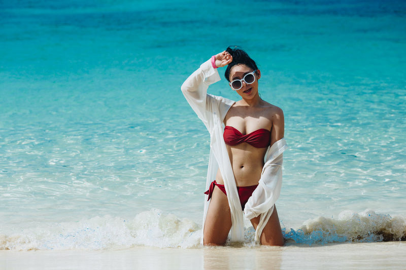Water Sea Young Adult One Person Lifestyles Leisure Activity Front View Land Swimwear Beach Standing Three Quarter Length Real People Young Women Bikini Adult Holiday Beautiful Woman Outdoors
