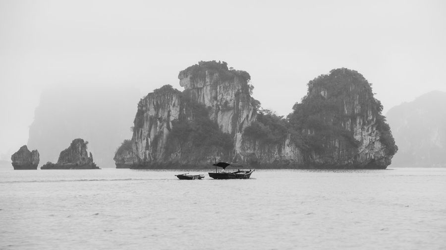 Water Nautical Vessel Sea Mode Of Transportation Rock Transportation Scenics - Nature Waterfront Rock - Object Rock Formation Sky Tranquil Scene Cliff Solid Nature Beauty In Nature Tranquility Day Clear Sky No People Outdoors Formation Passenger Craft Ha Long Bay