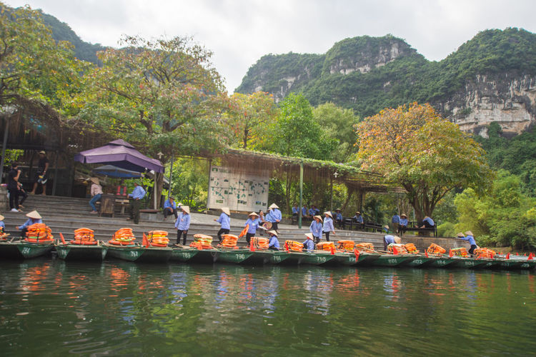 tourist sitting on boat at Trang An, Ninh Binh, Vietnam. Nautical Vessel Group Of People Water Real People Tree Crowd Large Group Of People Transportation Plant Nature Mode Of Transportation Men Day Waterfront River Lifestyles Women Sky Outdoors