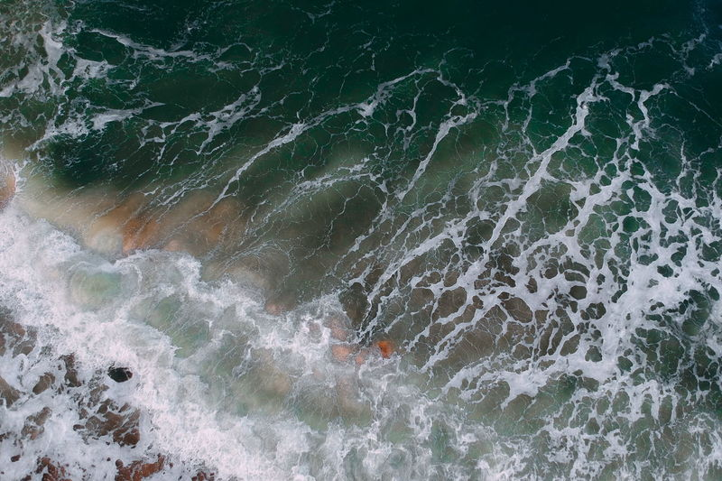 aerial view of sea waves water texture background Motion Sea Water Sport No People Wave Aquatic Sport Nature Full Frame Beauty In Nature Backgrounds High Angle View Day Outdoors Land Rock Pattern Solid Abstract Power In Nature Breaking