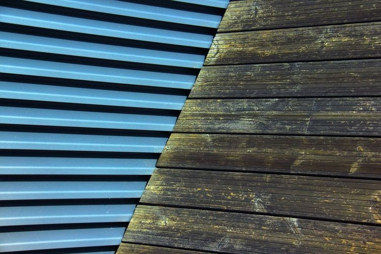 Close-up of metallic and wooden wall