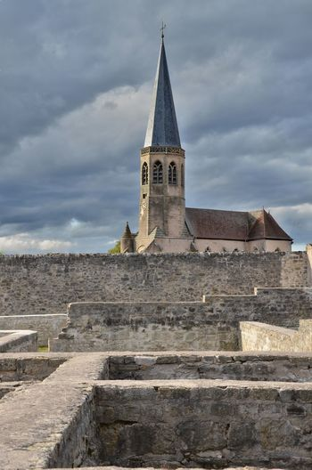 Architecture Bell Tower Building Exterior Built Structure Church Cloud Cloud - Sky Cloudy Day France History Lorraine Low Angle View No People Outdoors Place Of Worship Religion Sky Spirituality The Past Tourism Travel Destinations Village Wall