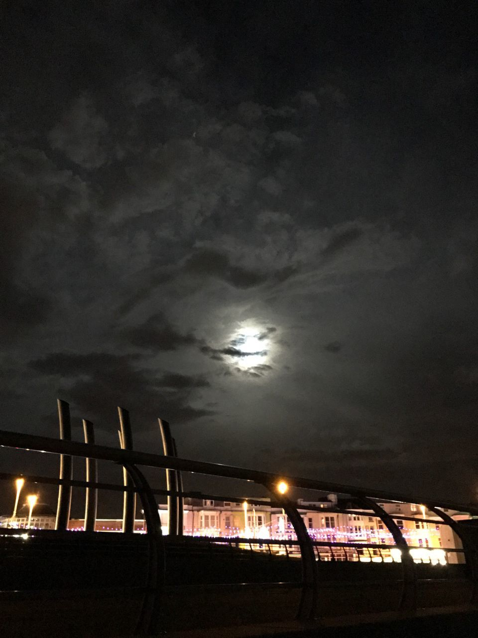 sky, night, illuminated, cloud - sky, moon, low angle view, built structure, no people, outdoors, silhouette, sunset, nature, beauty in nature, architecture, scenics, building exterior, city