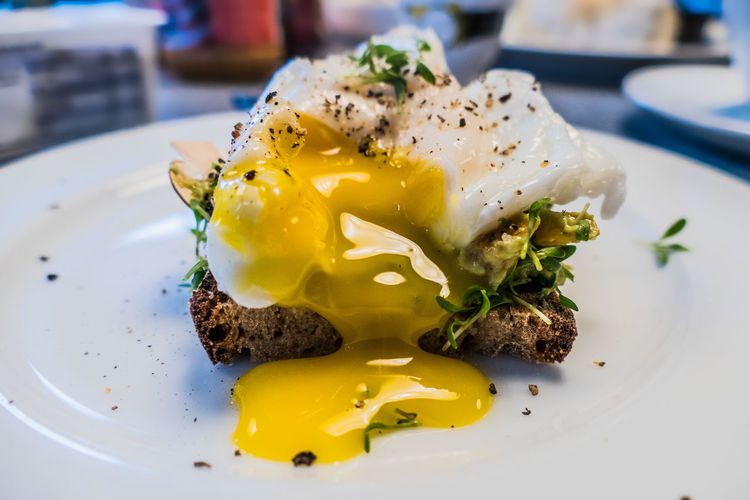Breakfast with avocado, egg and bread Avocado Bread Breakfast Close-up Day Dishes Egg Egg Yolk Eggs Food Foodphotography Fresh Freshness Healthy Eating Herbs Indoors  No People Poached Eggs  Ready-to-eat Yellow