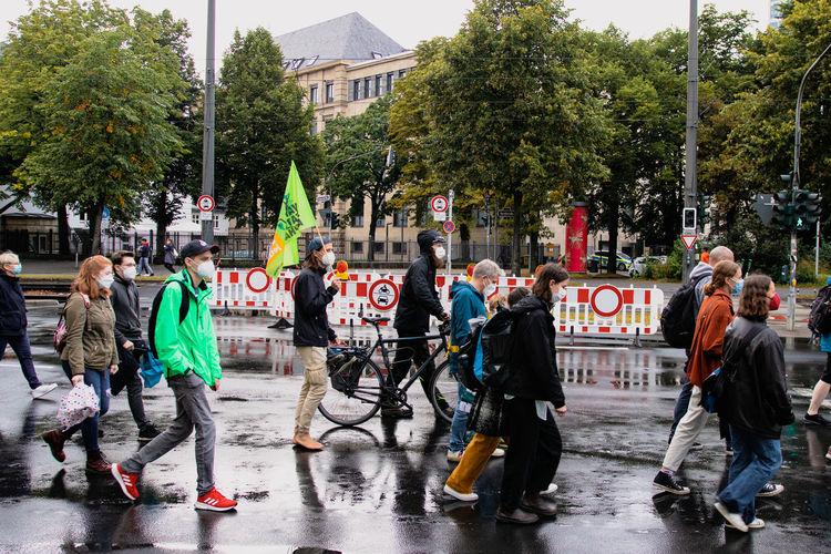 People on street in rain