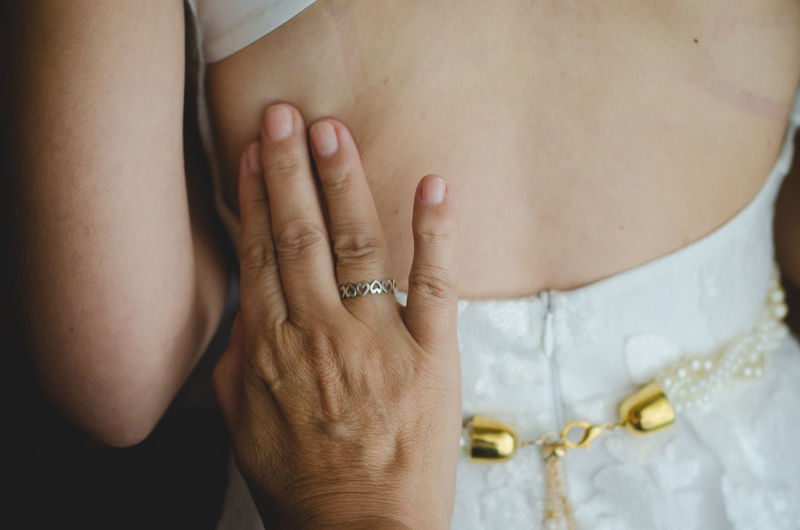 Cropped hand touching bride