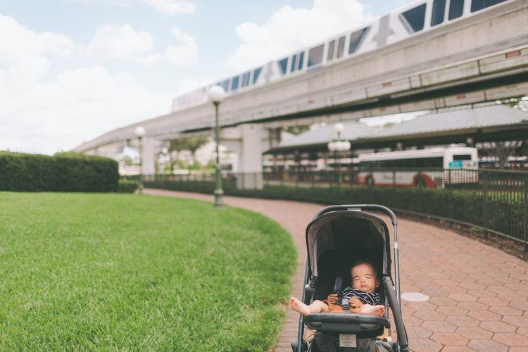 Baby boy in stroller at park