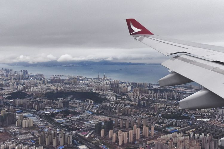 Cityscape Aerial View Sky No People City Outdoors Flying Day Architecture Nature Quingdao China Aircraft Wing From My Point Of View Check This Out Travel Destinations Cold Temperature Cloud - Sky
