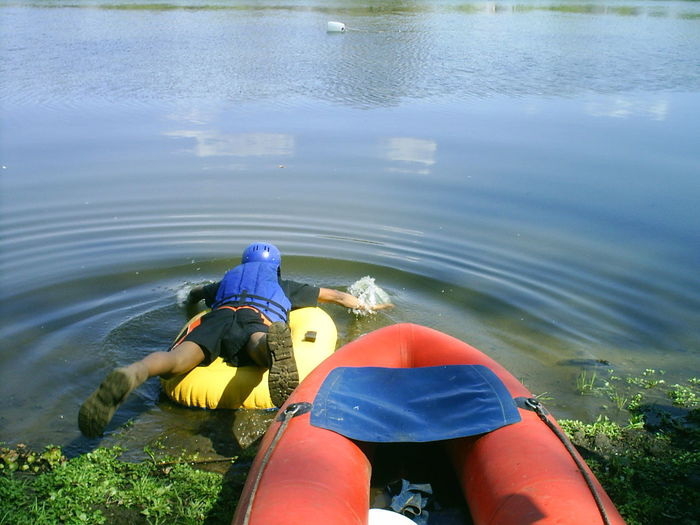 Full Length Rear View Of Man On Inflatable Raft Paddling On Lake