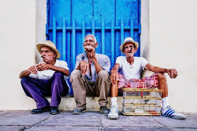 Cigar Blue Havana Trinidad Cuban Cuba EyeEm Selects Real People Sitting Architecture Building Exterior Day Wall - Building Feature Men Group Of People People Lifestyles