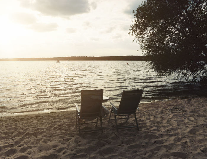 Absence Beach Beauty In Nature Chair Empty Horizon Over Water Land Luxury Nature No People Outdoors Relaxation Sand Scenics - Nature Sea Seat Sky Tranquil Scene Tranquility Tree Water