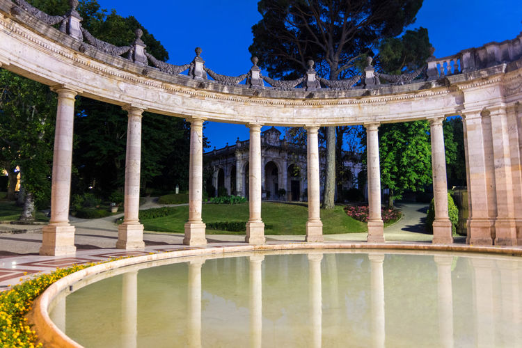 Ancient Ancient Civilization Archaeology Architectural Column Architecture Building Exterior Built Structure Courtyard  Day History Lake Nature No People Outdoors Plant Reflecting Pool Reflection Sky The Past Tourism Travel Travel Destinations Tree Water
