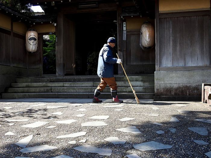 Real Life Real People Architecture One Person Built Structure Sunlight Full Length Real People Lifestyles Men Cleaning Broom