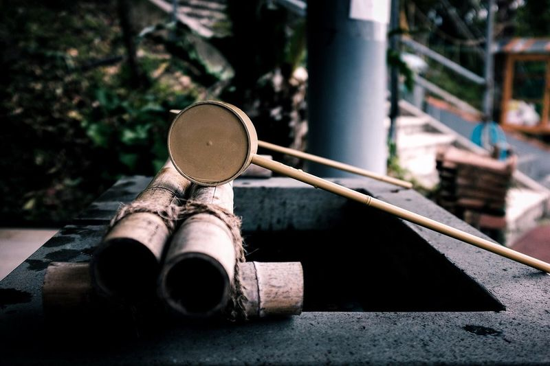Close-up of wooden ladle on drinking water