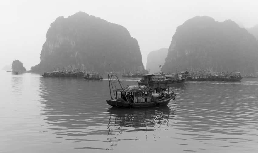 Nautical Vessel Water Mode Of Transportation Transportation Sea Waterfront Beauty In Nature Nature Tranquility Mountain Day Tranquil Scene Scenics - Nature Sky Rock Travel Clear Sky Rock Formation Sailing Outdoors No People Sailboat Bay Ha Long Bay
