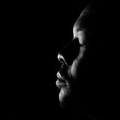 Digital composite image of man in darkness