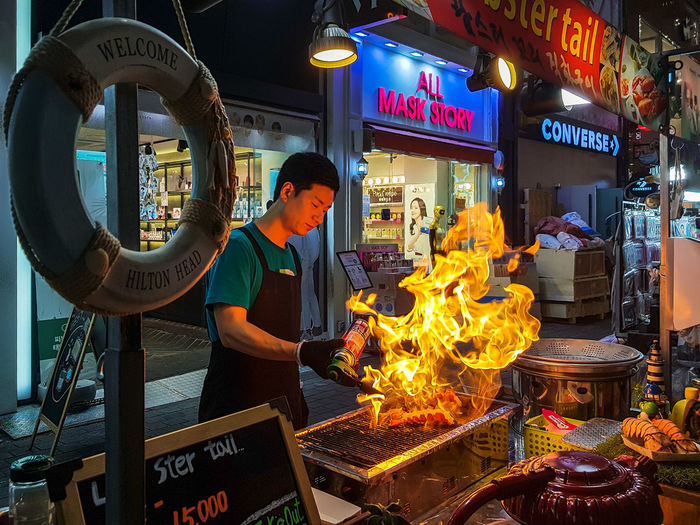 Street food Street Streetphotography Food Night Nightphotography Korea EyeEmNewHere EyeEm Best Shots EyeEm Selects EyeEm Gallery Eye4photography  EyeEm Working Occupation Illuminated Men Standing Heat - Temperature
