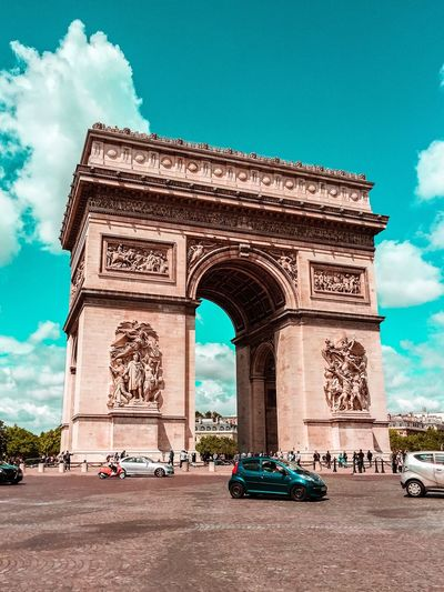 Triumphal Arch Sky Architecture Cloud - Sky Monument Arch Low Angle View Car History Outdoors Built Structure Sculpture Day City No People EyeEm Best Shots From My Point Of View The Week On EyeEm
