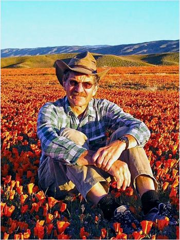 Dr. Rudolf (Rudi) Schmid, Professor of Botany, University of California, Berkeley, sitting in a field of California poppies (Eschscholzia californica:Papaveraceae) in the Antelope Valley Poppy Preserve, near Lancaster, CA. Check This Out Taking Photos The Portraitist - 2016 EyeEm Awards EyeEm Best Shots - Nature Showcase: May Botany From My Point Of View Poppy Flowers Poppies  California Poppies Orange Color EyeEm Gallery Malephotographerofthemonth Iphonephotography The Great Outdoors - 2016 EyeEm Awards Springtime Field Trip Field Of Flowers Southern California People And Places