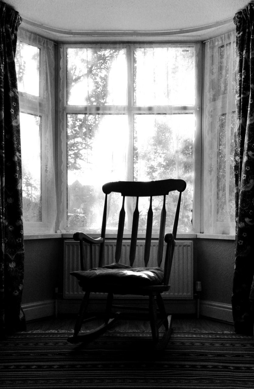 chair, seat, window, indoors, table, no people, absence, day, home interior, furniture, empty, rocking chair, glass - material, domestic room, transparent, curtain, wood - material, house, architecture