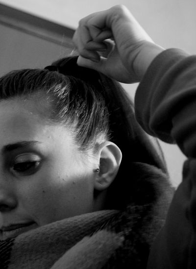 Cropped image of woman with hand in hair