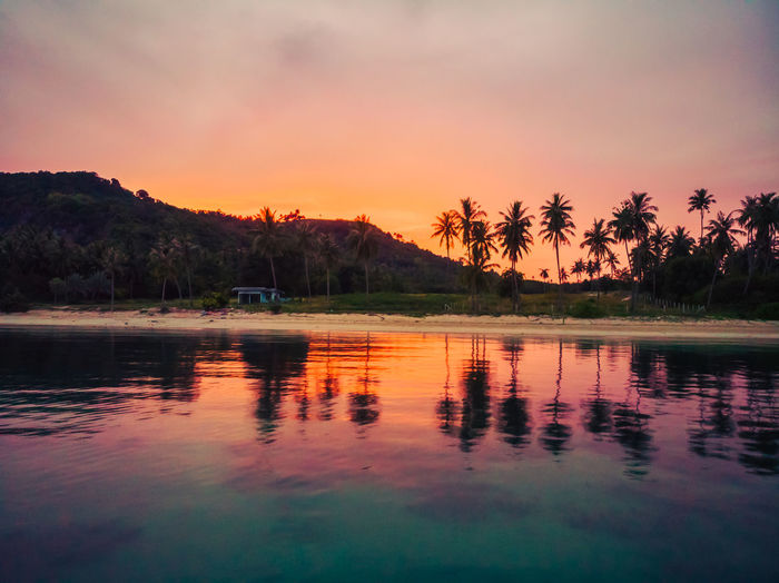 Beauty In Nature Idyllic Lake Mountain Nature No People Non-urban Scene Orange Color Outdoors Palm Tree Plant Reflection Scenics - Nature Sky Sunset Tranquil Scene Tranquility Tree Water Waterfront